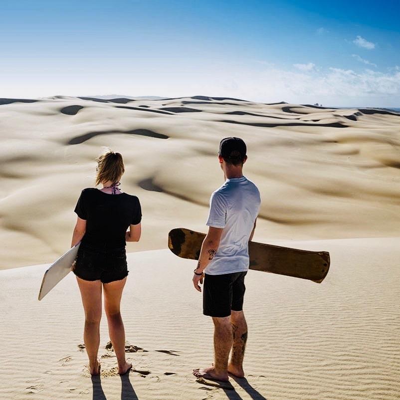 Sandboarden met de groepsreis Sydney Explorer