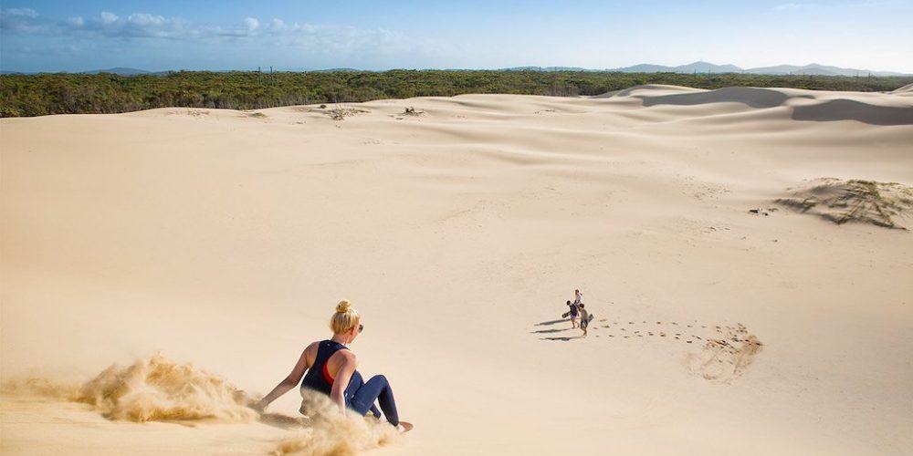 Sandboarden tijdens de Sydney Explorer Groepsreis